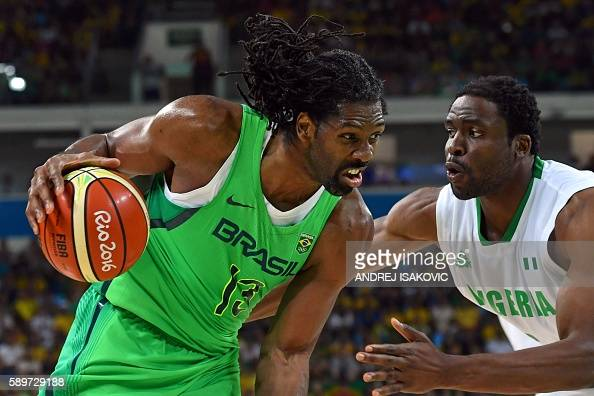 TOPSHOT Nigeria's power forward Ike Diogu holds off Brazil's centre Nene Hilario during a Men's round Group B basketball match between Nigeria and...