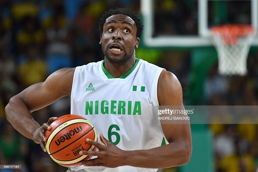 Nigeria's power forward Ike Diogu holds on to the ball during a Men's round Group B basketball match between Nigeria and Brazil at the Carioca Arena...