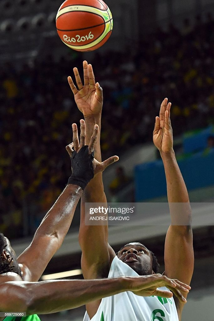 Nigeria's power forward Ike Diogu takes a shot over Brazil's centre Nene Hilario during a Men's round Group B basketball match between Nigeria and...