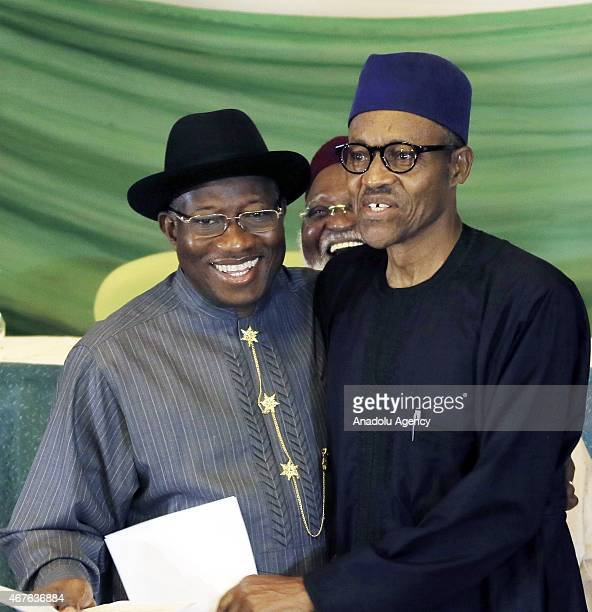 Nigeria's President Goodluck Jonathan and opposition candidate Gen Muhammadu Buhari pose after signing a renewal of their pledge to hold peaceful...