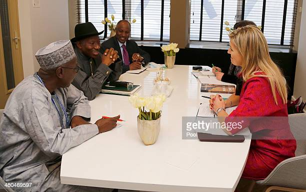 Nigeria's President Goodluck Jonathan meets Dutch Queen Maxima on the last day ofo the Nuclear Security Summit on March 25 2014 in The Hague the...