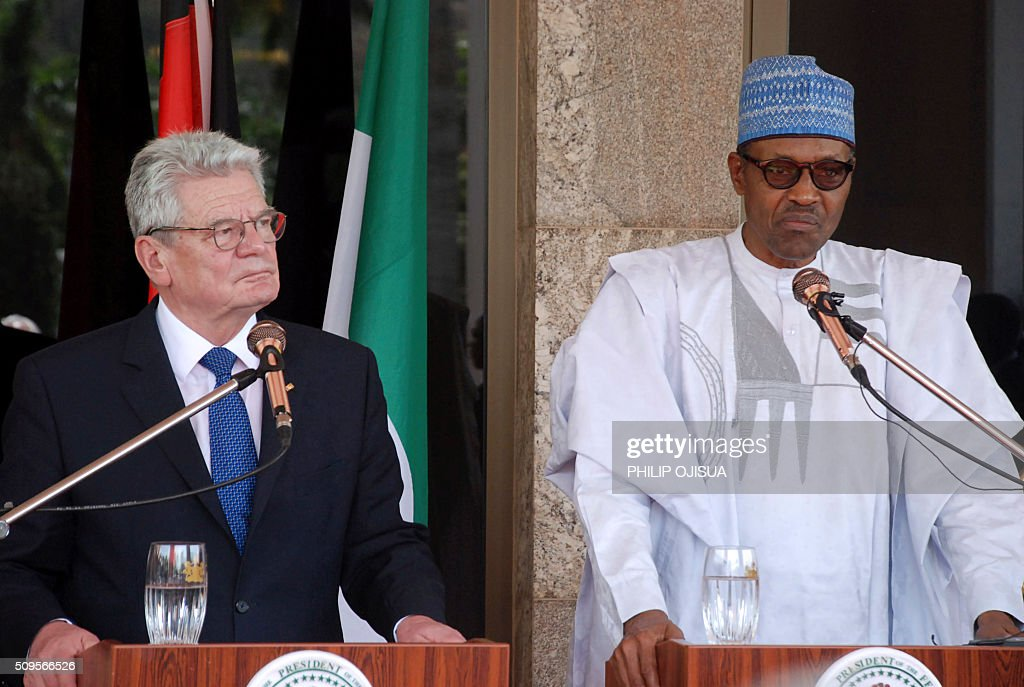 Nigeria's President Muhammadu Buhari (L) and German President Joachim Gauck (R) attend a joint press briefing at the presidency in Abuja, on February 11, 2016. Gauck, accompanied by his partner and top government functionaries as well as strong delegation from the business community, is in Nigeria to strengthen cooperation between the two countries. / AFP / PHILIP OJISUA