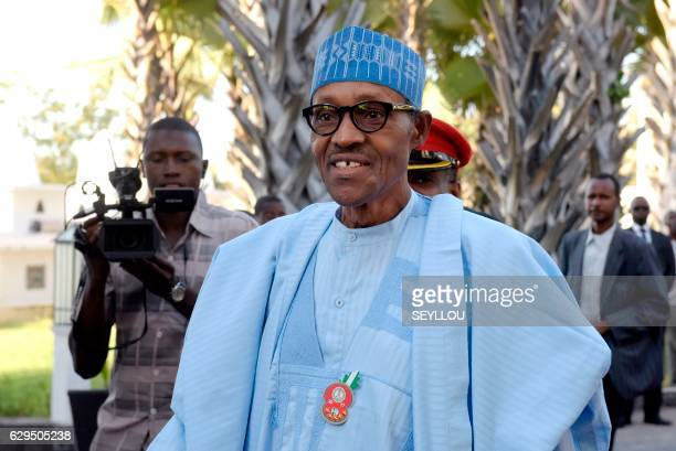 Nigeria's President Muhammadu Buhari arrives at a hotel in Banjul to meet with Gambian presidentelect with three other African heads of state on...