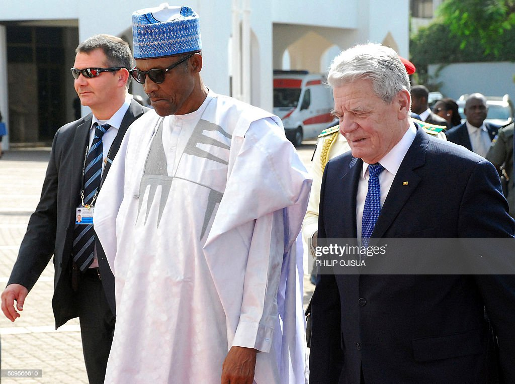 Nigeria's President Muhammadu Buhari (L) welcomes German President Joachim Gauck (R) at the presidency in Abuja, on February 11, 2016. Gauck, accompanied by his partner and top government functionaries as well as strong delegation from the business community, is in Nigeria to strengthen cooperation between the two countries. / AFP / PHILIP OJISUA