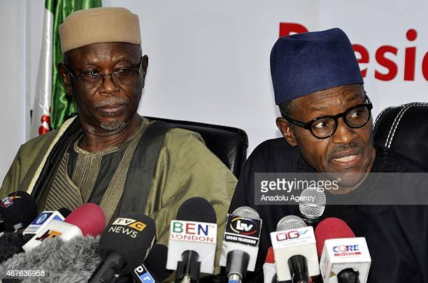 Nigerias presidential candidate Gen Muhammadu Buhari and chairman of the All Progressives Congress John Odigie hold a press conference after signing...