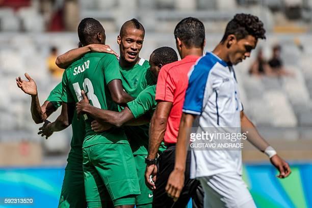 TOPSHOT Nigeria's Sadiq Umar celebrates with teammates after scoring against Honduras during the Rio 2016 Olympic Games men's bronze medal football...