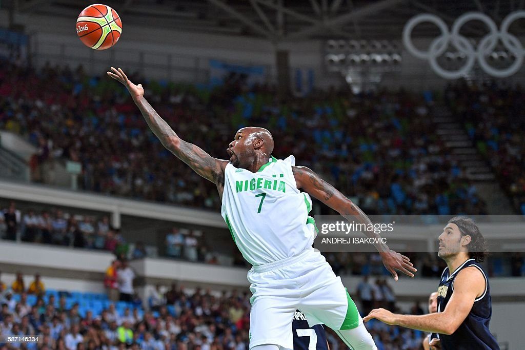 Nigeria's small forward AlFarouq Aminu goes to the basket during a Men's round Group B basketball match between Nigeria and Argentina at the Carioca...