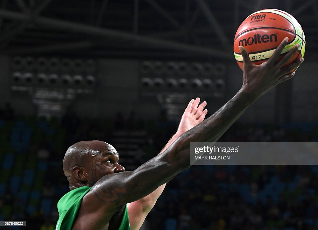 Nigeria's small forward AlFarouq Aminu jumps for a basket during a Men's round Group B basketball match between Lithuania and Nigeria at the Carioca...