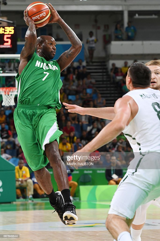 Nigeria's small forward AlFarouq Aminu throws the ball during a Men's round Group B basketball match between Lithuania and Nigeria at the Carioca...