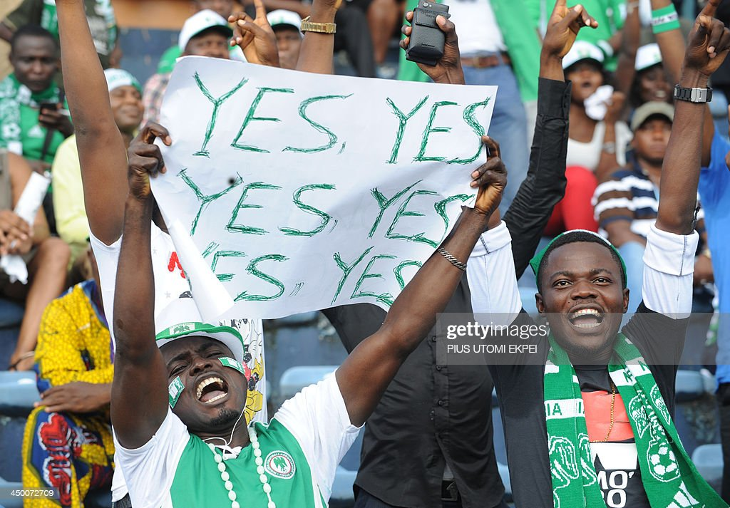 Nigeria's supporters celebrate their qualification for the FIFA 2014 World Cup in Brazil after winning the second leg qualifying football match between Nigeria and Ethiopia in Calabar in November 16, 2013. Nigeria defeated Ethiopia 2-0. AFP PHOTO/PIUS UTOMI EKPEI