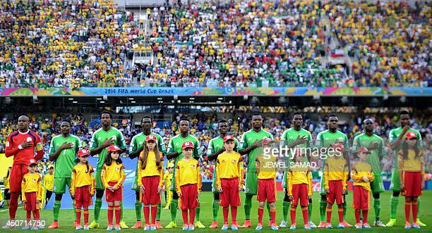 Nigeria's team pose before a Group F football match between Iran and Nigeria at the Baixada Arena in Curitiba at the 2014 FIFA World Cup on June 16...