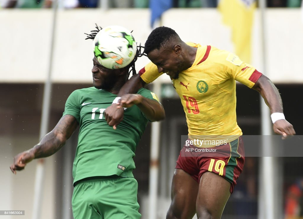 Nigeria's Victor Moses (L) heads the ball with Cameroon's defender Ngoran Fai during the 2018 FIFA World Cup qualifying football match between Nigeria and Cameroon at Godswill Akpabio International Stadium in Uyo, southern Nigeria, on September 1, 2017. /
