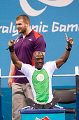 Nigeria's Ykubu Adesokan celebrates after setting a world record of 180kg in the men's 48kg powerlifting on day one of competition at the 2012 London...