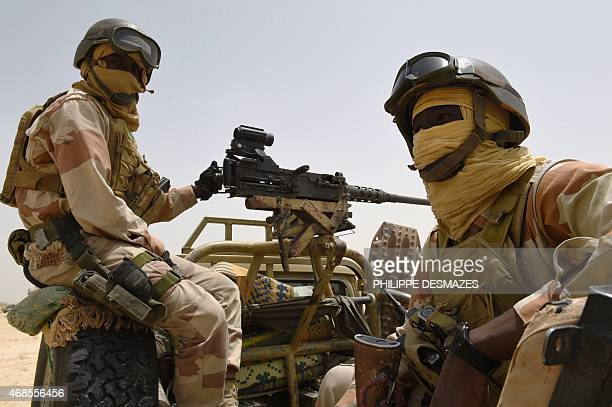 Nigerien army forces sit in the back of an armed pickup truck at their base near Malam Fatori on April 3 after the town in northeastern Nigeria was...