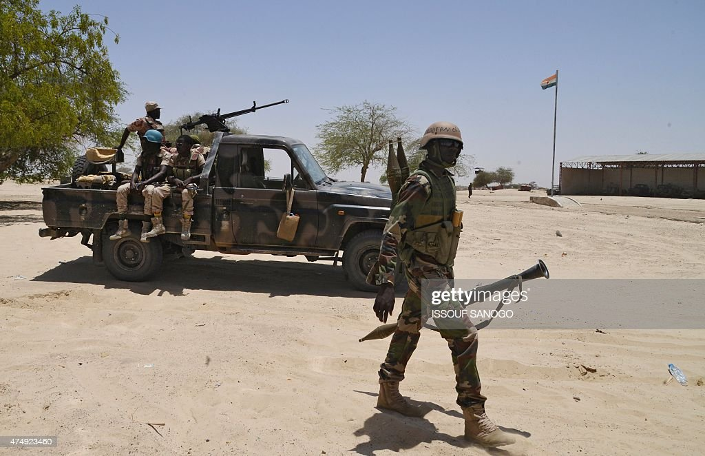Nigerien soldiers patrol along the Nigerian border, near the south-eastern city of Bosso, on May 25, 2015. Niger has extended for three months the state of emergency in its southeastern Diffa region where the army has been battling Boko Haram militants since February, authorities announced on May 27, 2015. The operation, nicknamed Barkhane, which succedeed to Serval one, is taking place across Mauritania, Mali, Burkina Faso, Niger and Chad and involves a total 3,000 French troops.