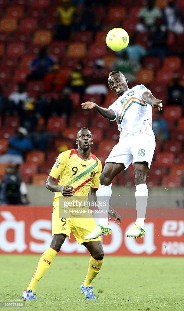 Niger's defender Koffi Dan Kowa (R) fights for the ball with Mali's forward Cheick Tidiane Diabate during the 2013 Africa Cup of Nations football match at Nelson Mandela Bay Stadium in Port Elizabeth on January 20, 2013.