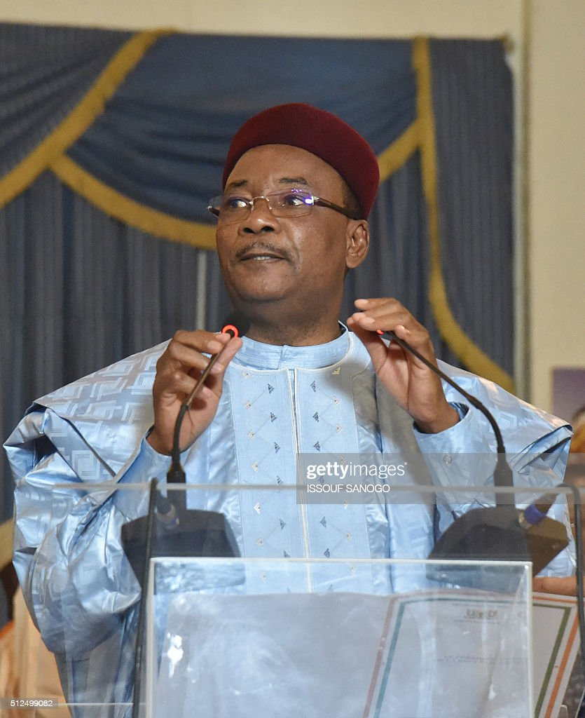 Niger's incumbent president <a gi-track='captionPersonalityLinkClicked' href=/galleries/search?phrase=Mahamadou+Issoufou&family=editorial&specificpeople=2329822 ng-click='$event.stopPropagation()'>Mahamadou Issoufou</a> delivers a speech at the presidential palace in Niamey on Febuary 26, 2016. Niger's President <a gi-track='captionPersonalityLinkClicked' href=/galleries/search?phrase=Mahamadou+Issoufou&family=editorial&specificpeople=2329822 ng-click='$event.stopPropagation()'>Mahamadou Issoufou</a> took a clear lead in the country's February 21 presidential election but will face a run-off against jailed opposition leader Hama Amadou, official results showed today. / AFP / ISSOUF