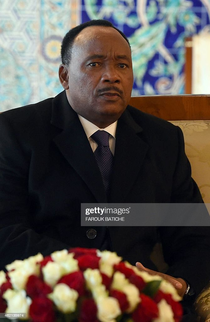 Niger's President <a gi-track='captionPersonalityLinkClicked' href=/galleries/search?phrase=Mahamadou+Issoufou&family=editorial&specificpeople=2329822 ng-click='$event.stopPropagation()'>Mahamadou Issoufou</a> looks on during a meeting with President of the Algerian Senate, Abdelkader Bensalah (unseen), upon his arrival at Houari Boumediene airport on the outskirts of the capital Algiers on January 25, 2015. Issoufou is on a three-day visit to Algeria for talks on the situation in Mali and Libya.