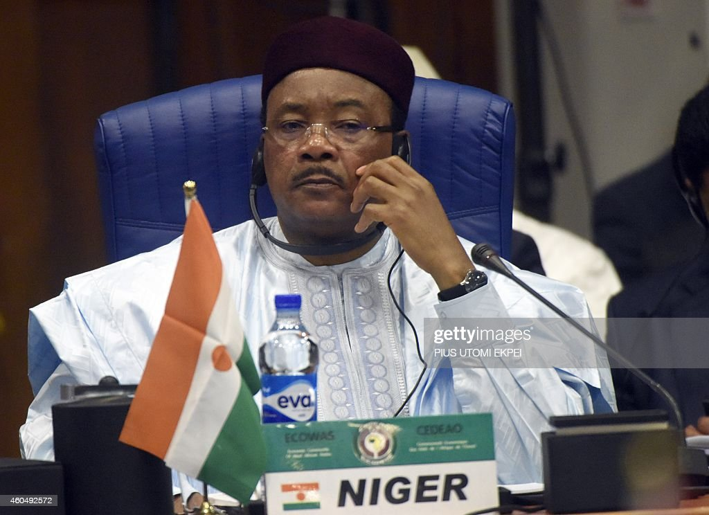 Niger's President <a gi-track='captionPersonalityLinkClicked' href=/galleries/search?phrase=Mahamadou+Issoufou&family=editorial&specificpeople=2329822 ng-click='$event.stopPropagation()'>Mahamadou Issoufou</a> looks on during the Summit of ECOWAS Heads of state and government in Abuja on December 15, 2014. Heads of states and government of ECOWAS are meeting in Abuja to discuss the on-going fight against the deadly Ebola virus disease that is ravaging the region, as well as the political and security situation in the region.