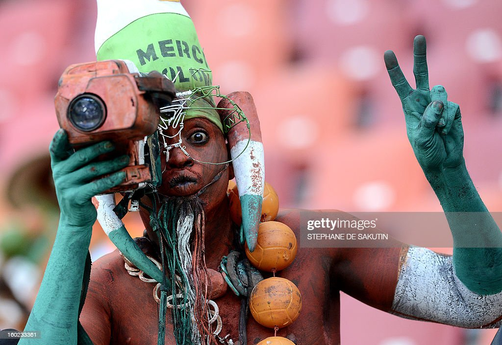 A Niger's Supporter poses with a camera prior a 2013 Africa Cup of Nations football match against Ghana at Nelson Mandela Bay Stadium in Port Elizabeth on January 28, 2013. AFP PHOTO / STEPHANE DE SAKUTIN