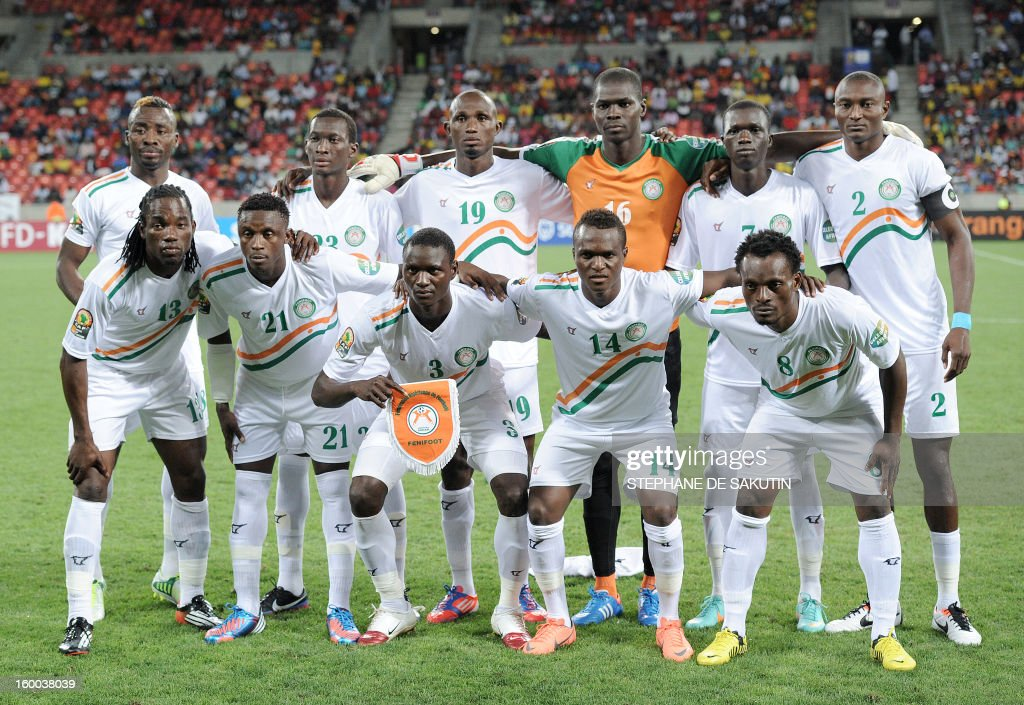Niger's team players pose on January 24, 2013 before a 2013 African Cup of Nation Group B football match against the Democratic Republic of Congo at Nelson Mandela Bay Stadium in Port Elizabeth. Front row, from left : defender Mohamed Chicoto, defender Mohamed Bachar, midfielder Karim Lancina, midfielder Issoufou Boubacar, defender Kourouma Fatoukouma. Back row, from left : defender Koffi Dan Kowa, defender Mohamed Soumaila, defender Issiaka Koudize, goalkeeper Daouda Kassaly, forward Modibo Sidibe, forward Moussa Maazou. AFP PHOTO / STEPHANE DE SAKUTIN