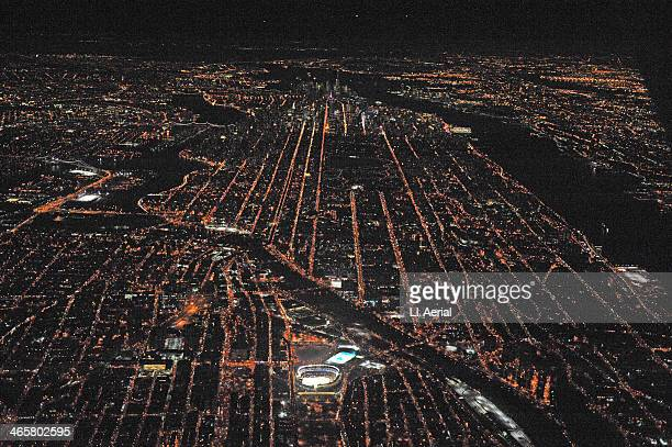 Night aerial view of a 2014 Coors Light NHL Stadium Series game between the New York Rangers and the New York Islanders at Yankee Stadium all lit up...