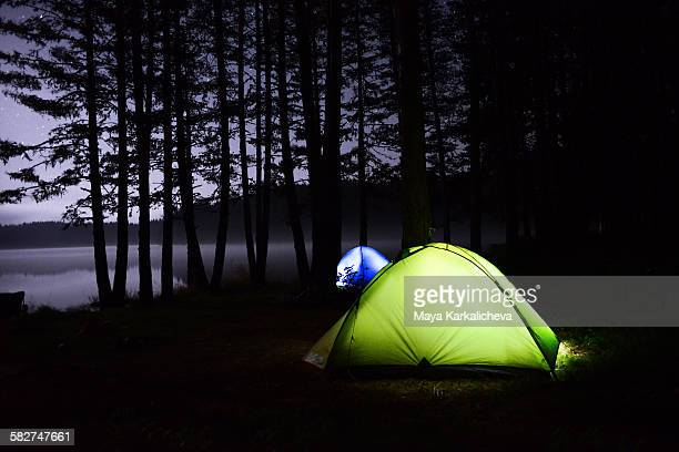 Night camping by the lake