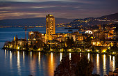 Night cityscape of Montreux Switzerland with land and ferris wheel.