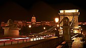 Night cityscape of the Chain bridge across the river Danube with the Buda castle in the background in the Hungarian capital, Budapest