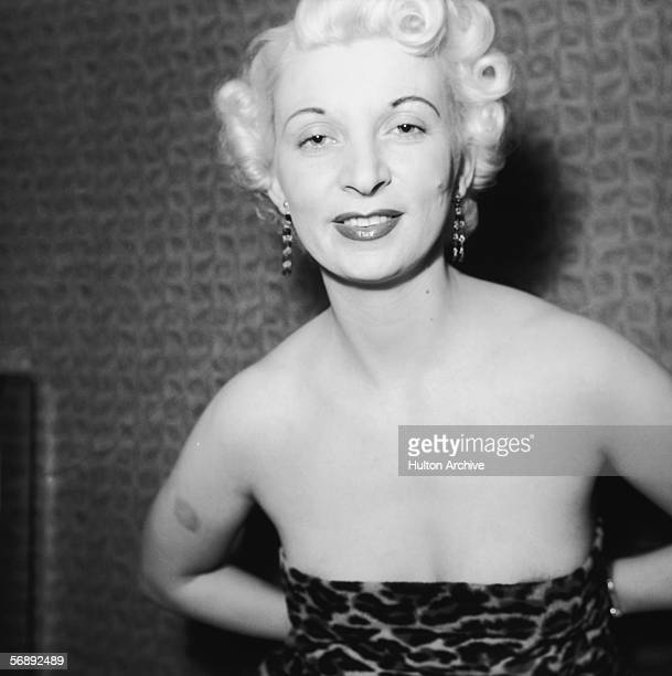 Night club manageress Ruth Ellis poses in leopard skin for one Captain Ritchie 1954 The setting is probably the flat above her club on the Brompton...