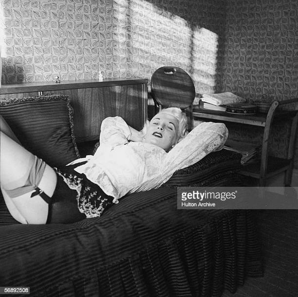 Night club manageress Ruth Ellis poses in stockings and suspenders for one Captain Ritchie 1954 The setting is probably the flat above her club on...