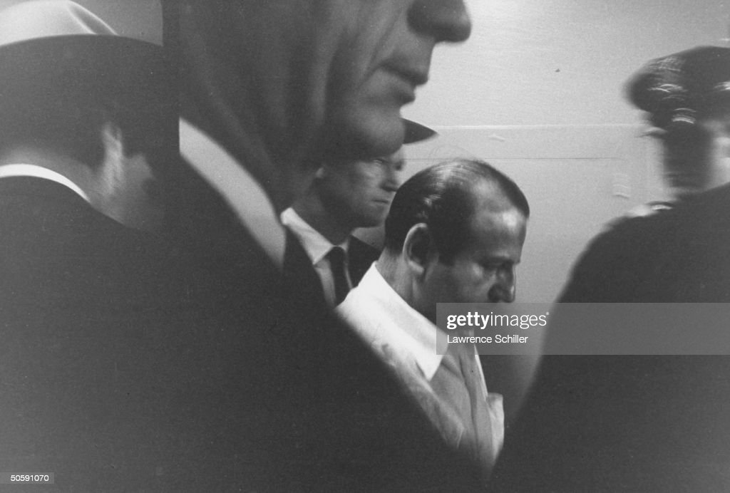 Night club owner Jack Ruby (C) surrounded by Dallas police shortly after killing Lee Harvey Oswald, alleged assassin of Pres. John Kennedy.