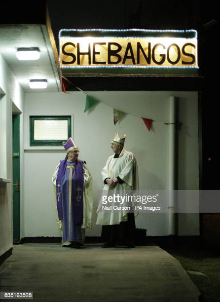 Night club security staff dressed as clergy men on the opening night of the third annual Father Ted Fest on Inis Mor Island on the west Coast of...