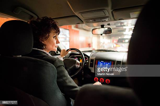 Night driving - business woman in car