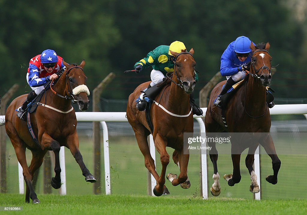 Night Hour ridden by Ted Durcan (r) holds off a challenge from Birkside ridden by David Allan to win the Big Fella & Silks Nightclub Pontefract Handicap Stakes run at Pontefract Racecourse on August 6, 2008 in Pontefract, England.