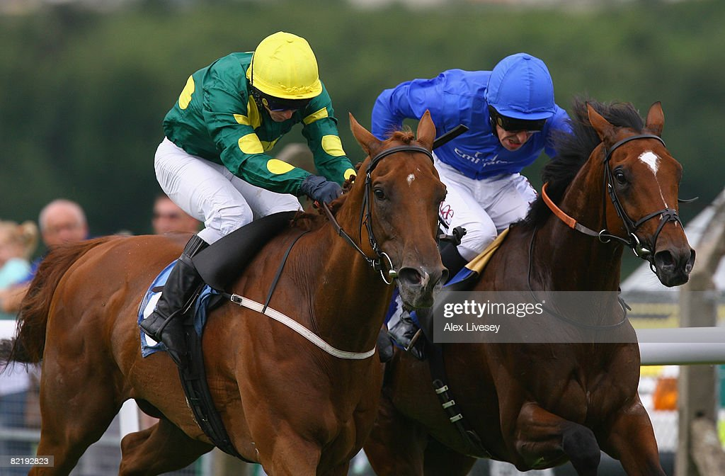 Night Hour ridden by Ted Durcan (r) holds off a challenge from Birkside ridden by David Allan (l) to win the Big Fella & Silks Nightclub Pontefract Handicap Stakes run at Pontefract Racecourse on August 6, 2008 in Pontefract, England.