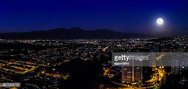 Night image of Caracas city aerial view with full moon
