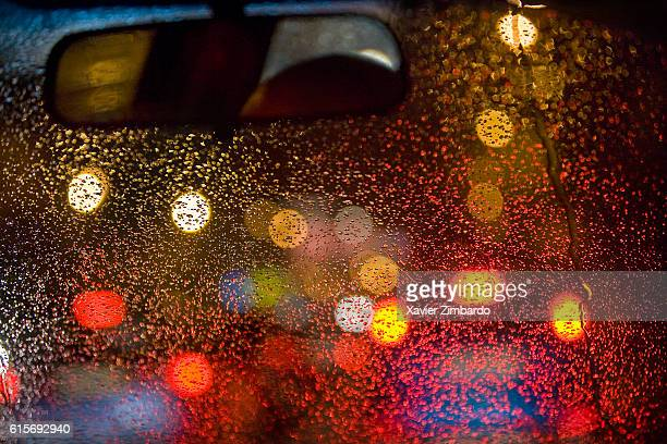 Night lights of traffic through the windscreen of a car during the rain on October 14 2006 at Moscow Russia