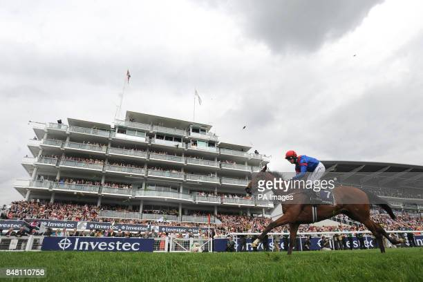 Night Lily ridden by jockey Jim Crowley rides past the Queen's stand in the Princess Elizabeth Stakes