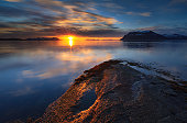 On june 1st 2011 there was a partial solar eclipse around midnight in Northern Norway. This is a shot from that session. Stunning light over VÃ¥gsfjorden in Troms.