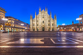 Piazza del Duomo, Cathedral Square, with Milan Cathedral or Duomo di Milano, Galleria Vittorio Emanuele II and Arengario, during morning blue hour, Milan, Lombardia, Italy