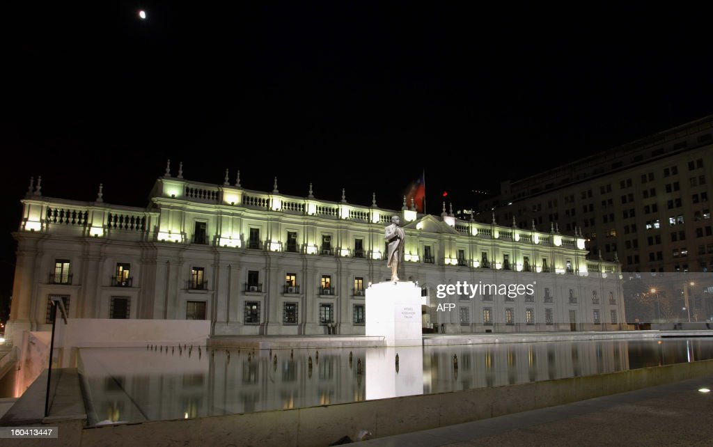A night picture of La Moneda Presidential Palace, in Santiago on February 12, 2010. AFP PHOTO / Claudio Santana /