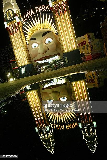 Night pictures of Luna Park the face reflected in a puddle 14 July 2005 SMH Picture by ROBERT PEARCE