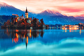 Night scene of Bled lake in Slovenia, famous and popular travel destination for romantic couple in love. Artistic toning landscape.