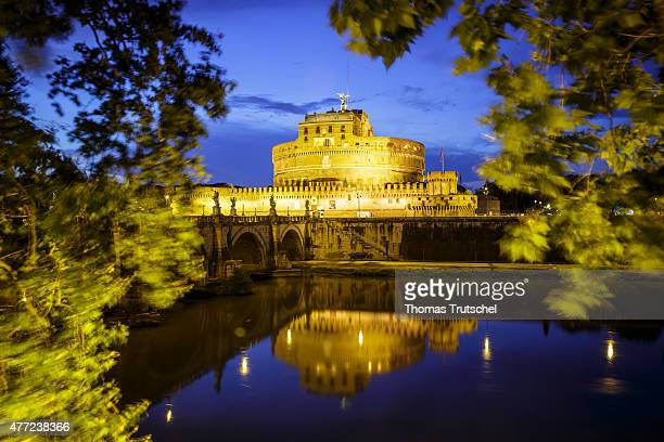 Night Scene of the Mausoleum of Hadrian usually known as Castel Sant'Angelo and the Ponte Sant'Angelo a Roman bridge on June 10 in Rome Italy The...
