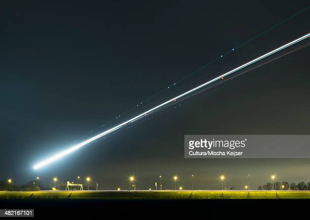 Night shot of airplane approaching Schiphol airport, Amsterdam, Netherlands