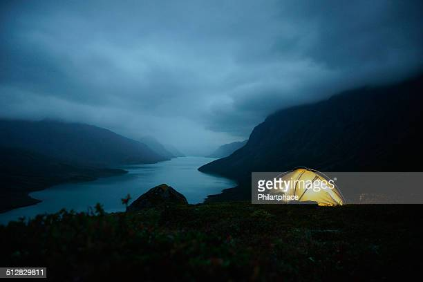 night shot of illuminated tent in the Jotunheimen national park