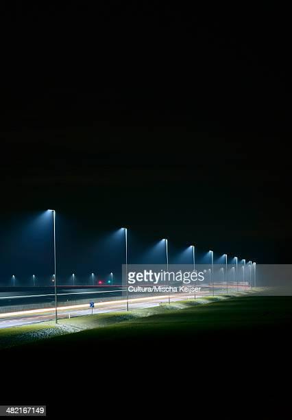 Night shot of new road build on land reclaimed from sea, Rotterdam harbor, Massvlakte, Rotterdam, Netherlands