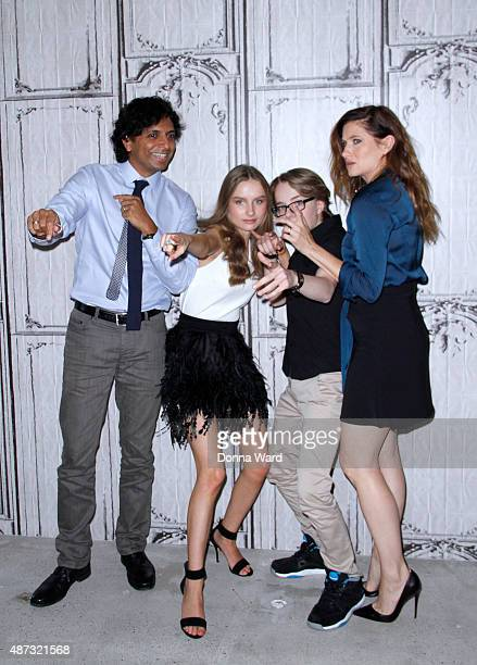 M Night Shyamalan Olivia DeJonge Ed Oxenbould and Kathryn Hahn pose before discussing 'The Visit' during the AOL Build Series at AOL Studios In New...
