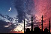 Night sky landscape mosque silhouette, Crescent moon stars, Ramadan Kareem celebration.Night sky landscape mosque silhouette, Crescent moon stars, Ramadan Kareem celebration.